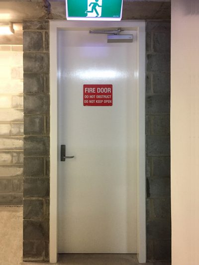 Fire-rated doors — New frame and fire door with signage